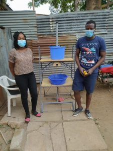 Victor & Angela after assessment of handwashing station manufactured by Fablab