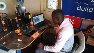 Bramwel calibrating the newly acquired Prusa printers ready for the production of more PPEs